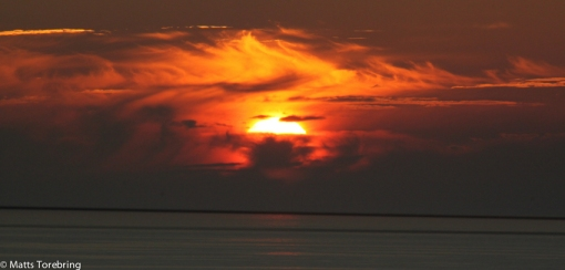 Solnedgång i Normandie